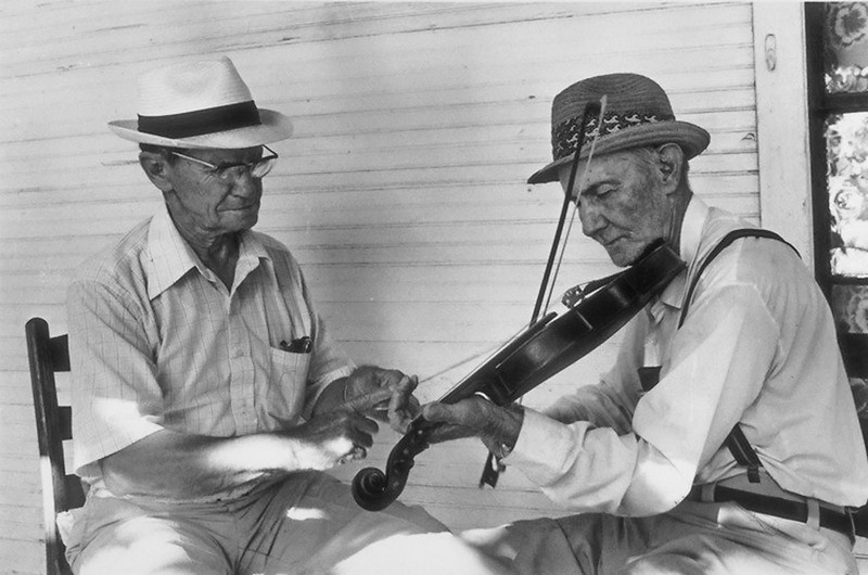 Arthur Griffin, left, is playing the straws or fiddlesticks and John is playing the fiddle.