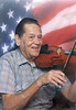 Ernest J. Smith (1927 ----) an accomplished musician, playing the fiddle, banjo, and harmonica, finds great joy in his music. He was the 1999 Champion Fiddler in the Hoboken, Georgia Fiddle and Blue Grass Fest. He also writes gospel hymns and shares them generously.