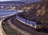 """50033 """"Glorious"""" passing Langstone Rock, Dawlish Warren, with 1O86, <br /> the 09:45 Plymouth - Waterloo, on 21st March 1992. Scanned Transparency."""