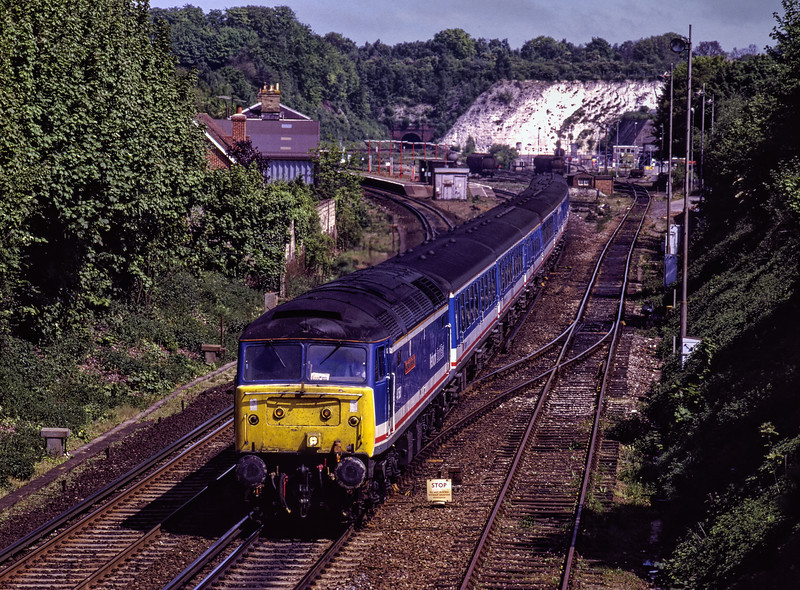 """47583 """"County of Hertfordshire"""" at Micheldever with 1V10, the 10:47 Basingstoke - Paignton, on 16th May 1992. Scanned Transparency."""