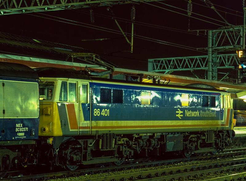 86401 at Crewe with 1S87, the 18:00 Birmingham New Street - Galsgow / Edinburgh, <br /> on 30th December 1986. Scanned Transparency.