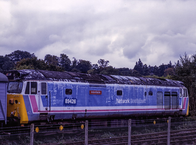 """50026 """"Indomitable"""" at Alton on 1st October 1994. Now sporting the current Tops number for the impending rail movement to MoD Bicester. Scanned Transparency."""