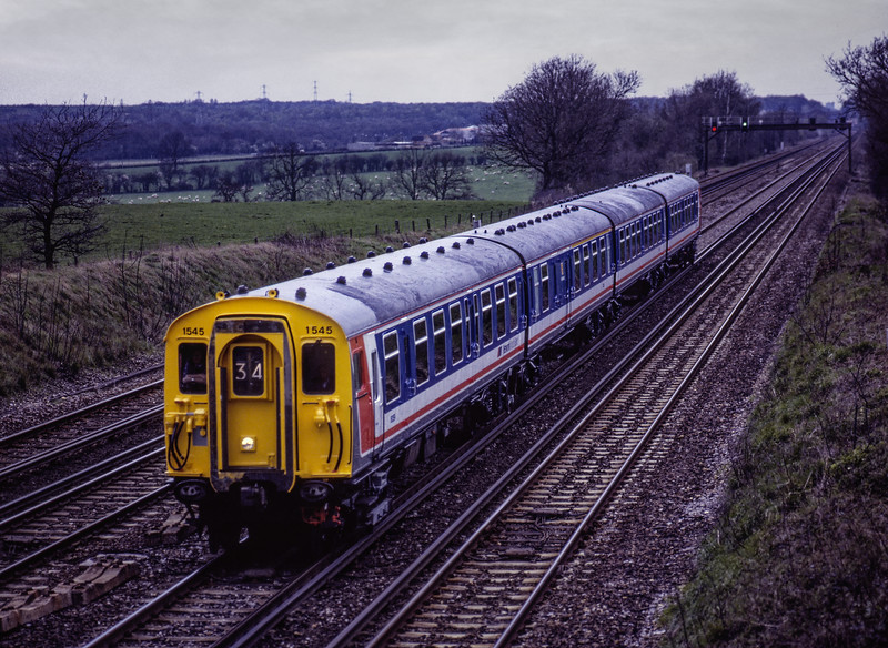 4-CEP No. 1545 at Totters Lane, Potbridge, working ECS to Wimbledon Park, <br /> on 16th April 1992. Scanned Transparency.