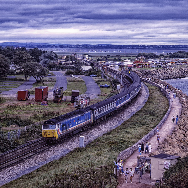 """50002 """"Superb"""" at Dawlish Warren with 1V12, the 11:59 Portsmouth Harbour - Plymouth, <br /> on 26th August 1988. Scanned Transparency."""