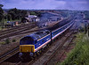 """47708 passes Andover with 1Z12, the 09:05 Paddington - Paignton, via Salisbury, <br /> on 9th June 1991. The train made a stop at Templecombe, where the loco was named """"Templecombe"""". Scanned Transparency."""