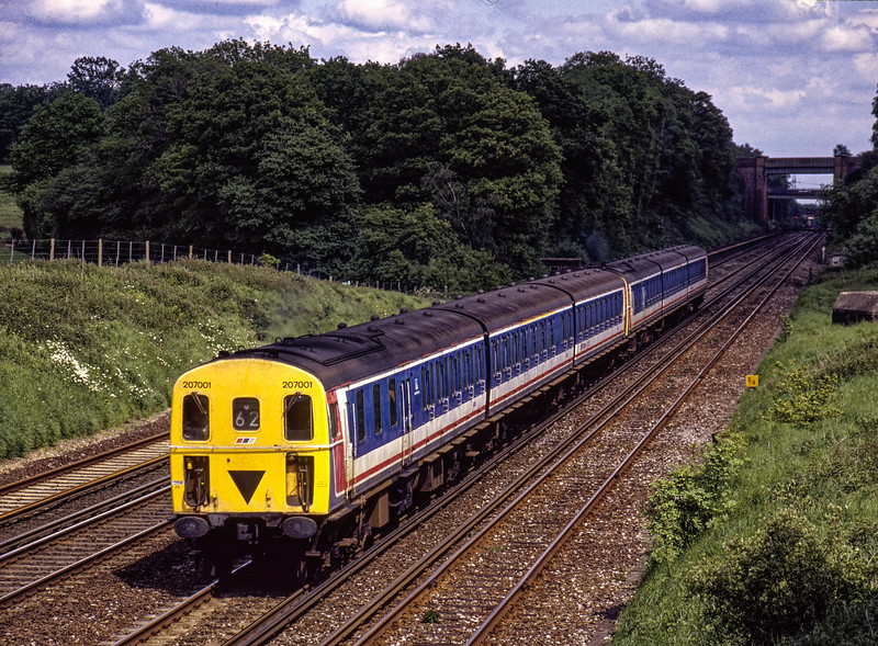 207001 and 207013 at Totters Lane, Potbridge, with 5Z22, the 14:17 Waterloo - Salisbury, <br /> on 22nd May 1993. This was the ECS from 1Z02, the 12:15 Salisbury - Waterloo, which was an additional service due to the late delivery of 159 units. Scanned Transparency.