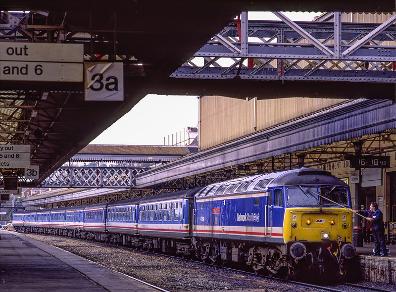 """47579 """"James Nightall G.C."""" at Exeter St Davids with 1O41, the 16:22 service to Waterloo, <br /> on 21st March 1992. Scanned Transparency."""