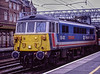 86401 at Crewe, with 1S80, the 12:30 Euston - Glasgow, on 11th September 1989. <br /> Scanned Transparency.