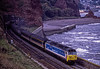 """50026 """"Indomitable"""" at Horse Cove, Dawlish with 1C41, the 13:02 Paddington - Paignton, <br /> on 30th September 1989. Scanned Transparency."""