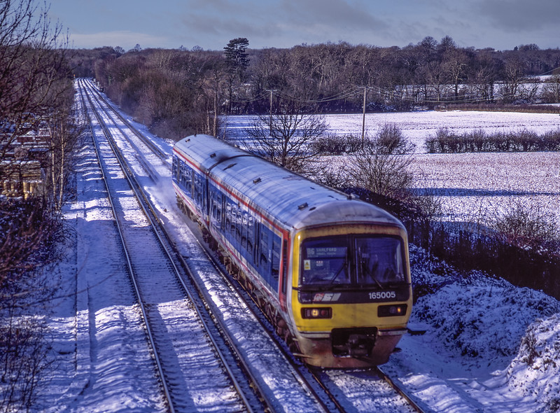 165005 at Wanborough with the 10:07 Reading - Shalford, on 31st January 2003. <br /> Scanned Transparency.