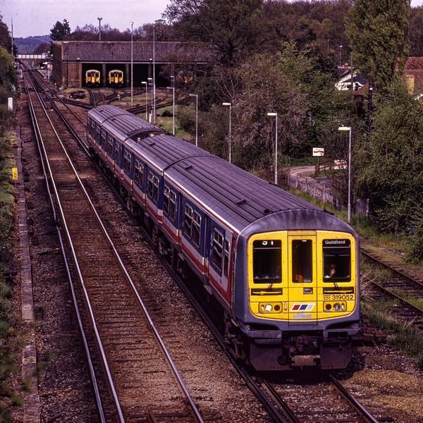 319052 at Effingham Junction with the 13:48 Luton - Guildford, Thameslink service, <br /> on 24th April 1993. Scanned Transparency.