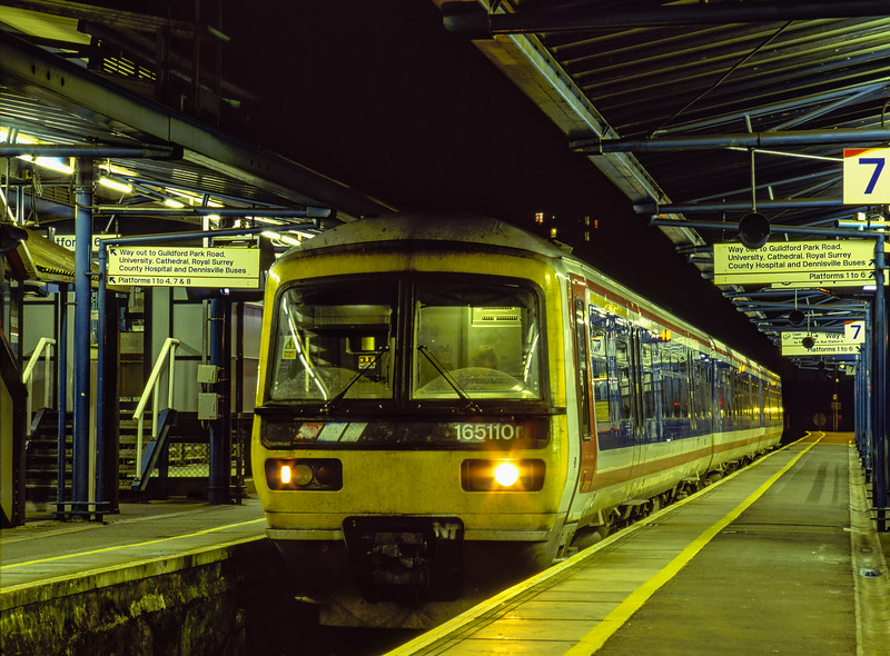 165110 at Guildford with the 17:45 Redhill - Reading, on 28th October 2001. <br /> Scanned Transparency.