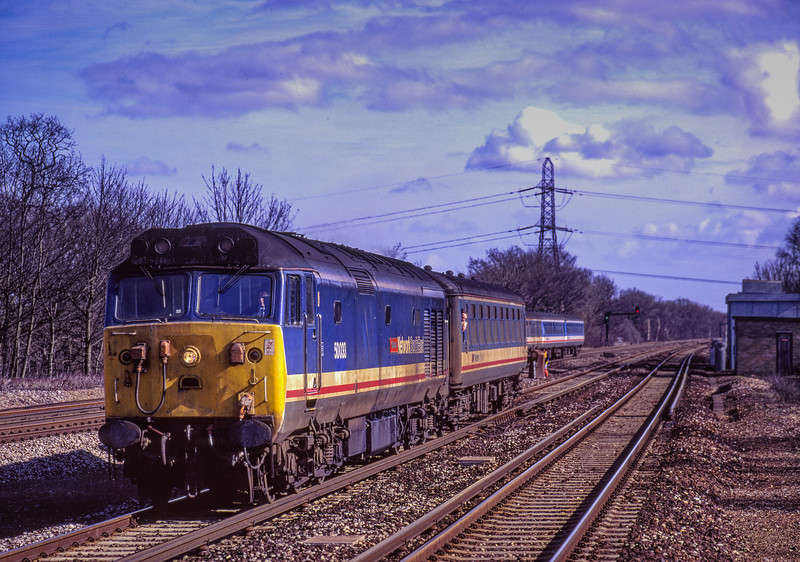 """50033 """"Glorious"""" at Winchfield with 1V11, the 10:55 Waterloo - Exeter St Davids, <br /> on 3rd March 1991. The train was setting back over the ETC to gain the up line, for SLW to Basingstoke. This was due to planned engineering work. Scanned Transparency."""