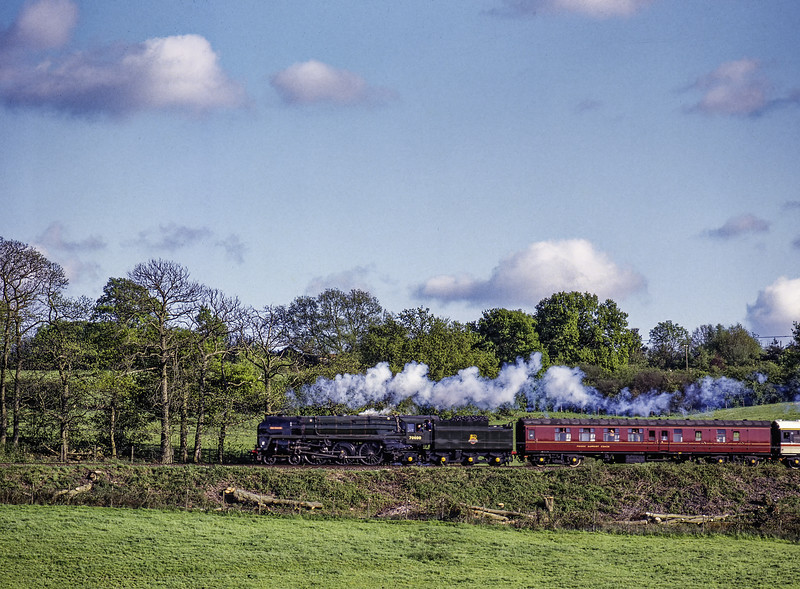 """70000 """"Britannia"""" running between Bentley and Farnham with the Alton - Waterloo <br /> """"Mid-Hants Daylight"""" return railtour, on 8th May 1994. Scanned Transparency."""