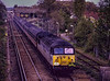 """56001 passes Effingham Junction with 1Z45, the 13:17 Waterloo - Salisbury leg of <br /> """"The Scratcher"""" railtour, organised by Pathfinder Tours on 24th April 1993. <br /> Scanned Transparency."""
