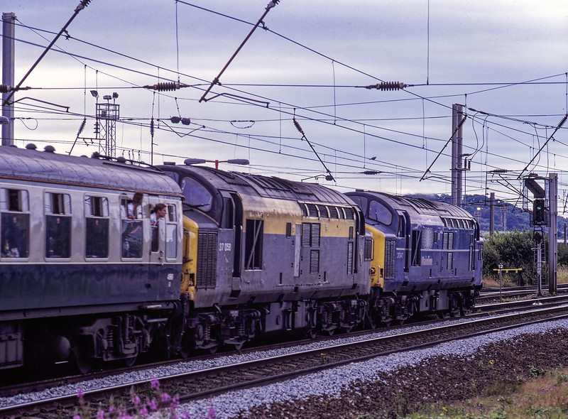 """37047 and 37058 at Warrington Bank Quay with 1Z42, the 12:15 Rylstone Quarry - Reading return railtour, on 17th July 1999. This was the """"Summer Syphony"""" <br /> organised by Pathfinder Tours. Scanned Transparency."""