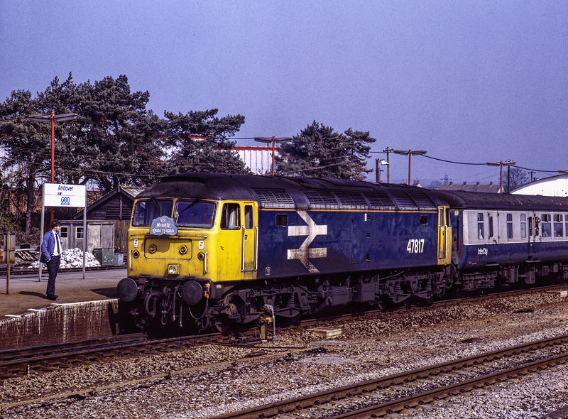"""47817 waiting in platform 1 at Andover, to access the Ludgershall branch with 1Z37, <br /> the 06:21 Manchester - Whatley Quarry and Merehead Quarry, on 31st March 1990. <br /> This was the """"Mendip Quarryman"""" organised by Pathfinder Tours.Scannned Transparency."""