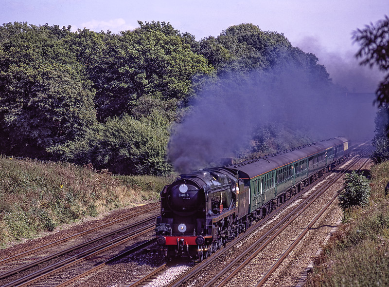 """WC No. 34016 """"Bodmin"""" at Totters Lane, Potbridge, with the 10:58 Waterloo - Salisbury, <br /> """"Cathedrals Express"""" on 30th August 2000. Scanned Transparency."""