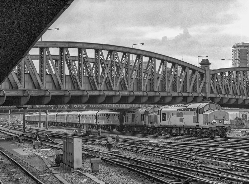 """37682 and 37685 arriving at Paddington with 1Z21, the 07:58 Manchester - Paddington via Brentford Goods, on 22nd June 1991. This was the """"Brentford Bard"""" organised by the Class 37 Group. The stock used, was the awful Pilkington liveried set. Scanned Negative."""