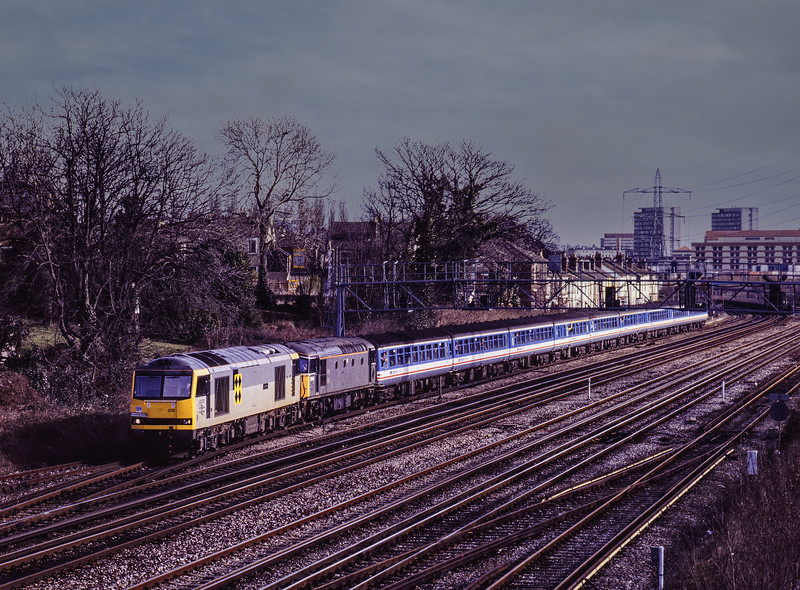 """60079 and 33109 depart from Southampton via the up goods loop, after reversal with 1Z24, the 10:12 Waterloo - Weymouth, on 16th February 1992. This was the <br /> """"Solent and Wessex Wanderer"""" organised by Network SouthEast. The train had travelled via Laverstock because of engineering work. Scanned Transparency."""