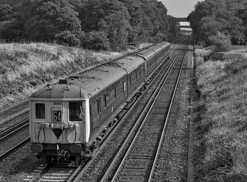 2-BIL 2090 and 4-SUB 4732 at Totters Lane, Potbridge with 2Z62, <br /> the 12:05 Woking - Basingstoke, on 27th September 1987. This was a special service run in connection with the Basingstoke Rail Show. Scanned Negative.