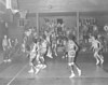 The Berrien Press, page 8, January 29, 1970<br /> Photo caption:<br /> TENSION – One of the big games of the county basketball play was in Enigma Saturday night with Alapaha boys edging out the home team, 45-44, in the final seconds of a tight, hard-fought game.  The score was tied, 43-43, with 15 seconds to go.  Enigma scored one on a free throw to make it 44-43.  With five seconds remaining Alapaha scored on a free throw to tie, 44-44.  Then Enigma fouled in carrying the ball downcourt and Alapaha made good the free throw.  Alapaha girls also won, 32-23.