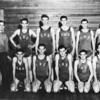 Enigma High School Boys Basketball Team, 1949-50<br /> Left to right: Front row–Kenneth Shearer, Coach; James Barentine, Carol Alexander, Donald Henderson, Charles Terry, Eugene Winn.<br /> Back row–D.L. Taylor, LaVerne Little, Ernest Pickard, Harry Allen, Aldine Danforth.