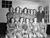 Nashville High School Girls Basketball Team 1947. Front row, left to right: Eloise Parker, Inez Luke, Jean Wilkes, Carolyn Weaver, Lawanna Shaw. Back row, left to right: Yvonne Studstill, Evelyn Hall, Wynelle Connell, Juanell Nix, Ethl Lee Bennett, Evelyn Avera, Carolyn Peters, Coach Lossie Gaskins.<br /> JC_LFN_000184_Basketball Tourn_Nashville_2-28-1947