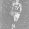 Tommie Vickers driving for layup against Cook County in 1955<br /> Vickers scored 24 points that game.