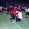 Jake Purvis (10) making tackle in 1999<br /> <br /> (photo by Gene Shearl)