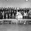 """Photo appears in 1955 BHS yearbook -- not athletics related.<br /> <br /> This is actually the Hi-Y or Tri-Hi-Y club.  (will have to check again for specifics)<br /> <br /> Even with all the """"N"""" jackets from NHS, this photo was taken in the BHS library.  We need verification that this was indeed the """"B"""" club and the year.  Lossie Gaskins is at middle of second row.<br /> <br /> Identification of others in the photo is needed."""