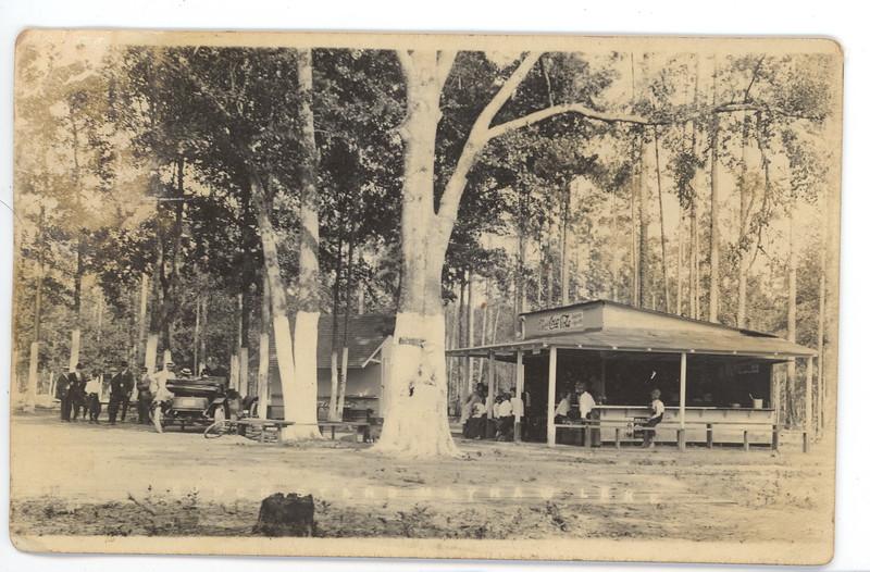 "Along bottom of photo (postcard), ""Lunch Stand Mayhaw Lake"""