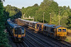 66722, 73107, 442415, 442420 and 73128 at Woking Junction with 5Q81, <br /> the 22:00 (28th) Bournemouth T&RSMD - Wolverton, on 29th July 2021. <br /> I believe that this was the final working of 442 units on the national network.<br /> 450034 / 014 and 057 are working the 06:30 Woking - Alton.