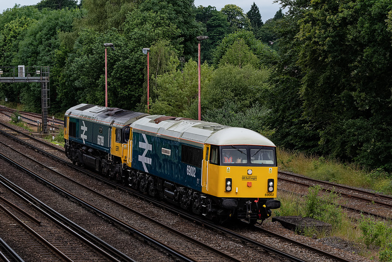 69002 and 66789 at Woking, Twin Bridges, with 0Z69, <br /> the 07:53 Eastleigh Works GBRF - Waterloo, on 10th July 2021. <br /> The 69 was going to be named at Waterloo.