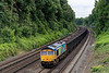 66720 at St Johns Hill Road, Woking, with 4Y19, the !2:30 Mountfield Sidings - Southampton West Docks, empty Gypsum, on 7th July 2021.