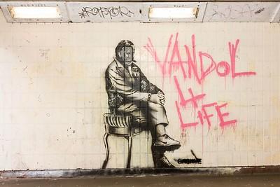 Man sat on chair by Graffiti Artist Justin Lewis (Enemie)