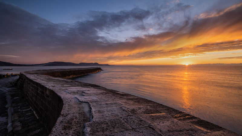 Dawn wall_New Years Day Sunrise At the Cobb Lyme Regis