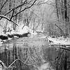 WFG 072<br /> <br /> Sawmill Creek flowing peacefully through a winter landscape after a fresh snowfall.