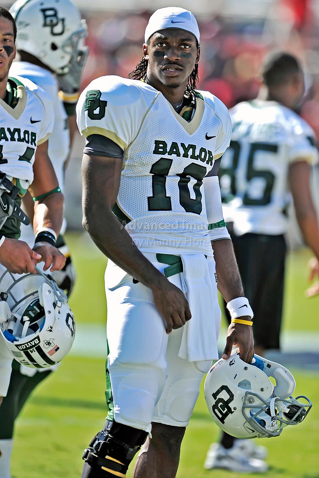Baylor Bears quarterback Robert Griffin III #10 in action<br /> before their game between the Texas Tech Red Raiders and the Baylor Bears at the Cotton Bowl Stadium in Dallas, Texas.  <br /> Texas Tech wins in a shootout 45-38.