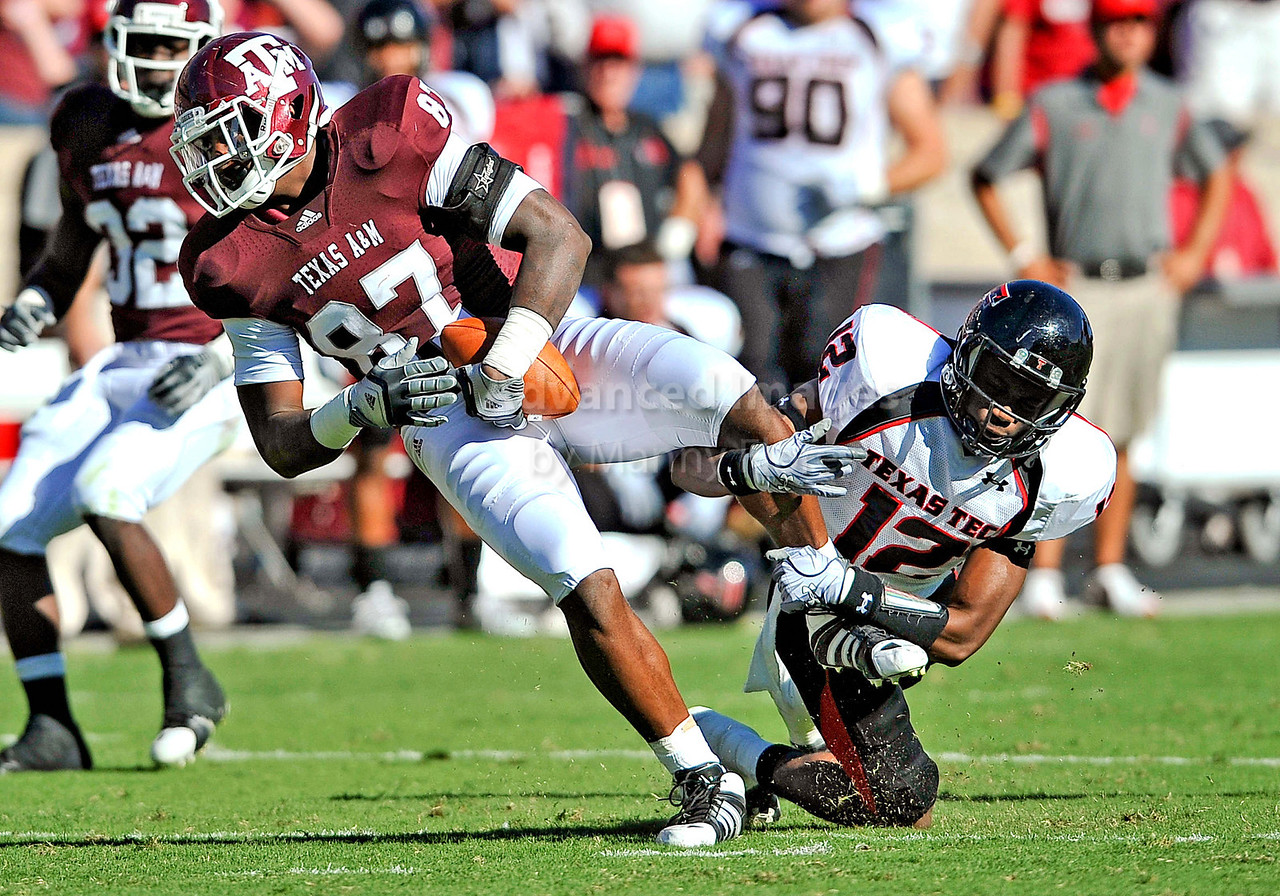 OCT 30 2010:  <br /> Texas A&M Aggies tight end Nehemiah Hicks #87 catches a pass for a first down and is tackled by Texas Tech Red Raiders cornerback D.J. Johnson #12 in a game between Texas Tech Red Raiders and Texas A&M Aggies at Kyle Field Stadium in College Station, Texas.<br />  Aggies win 45-27.<br /> (Credit Image: © Manny Flores/Cal Sport Media)