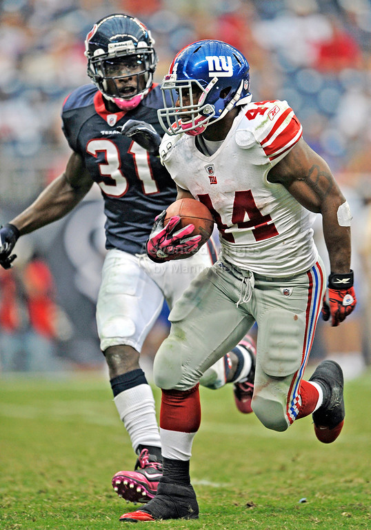 10 Oct 2010:  <br /> New York Giants running back Ahmad Bradshaw #44 runs the ball<br /> in a game between the New York Giants and the Houston Texans at Reliant Stadium in Houston Texas.<br /> Giants win 34-10