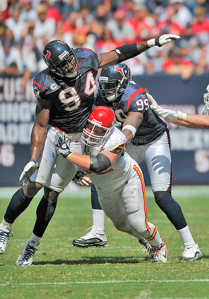 Oct 17 2010:  <br /> Houston Texans defensive end Antonio Smith #94 battles Kansas City Chiefs center Casey Wiegmann #62 in a game between Kansas City Chiefs and the Houston Texans at Reliant Stadium in Houston, Texas.<br /> Houston wins 35-31<br /> (Credit Image: © Manny Flores/Cal Sport Media)