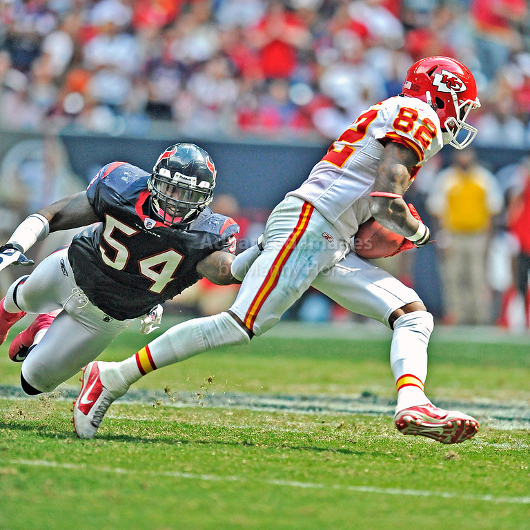 Oct 17 2010:  <br /> Houston Texans linebacker Zac Diles #54 tries to pull down Kansas City Chiefs wide receiver Dwayne Bowe #82<br /> in a game between Kansas City Chiefs and the Houston Texans at Reliant Stadium in Houston, Texas.<br /> Houston wins 35-31<br /> (Credit Image: © Manny Flores/Cal Sport Media)