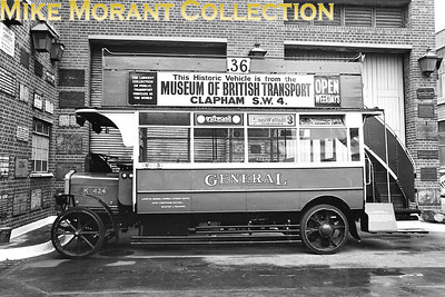 MUSEUM OF BRITISH TRANSPORT, CLAPHAM Preserved LGOC K 424 open top bus stored behind the museum on a damp afternoon in 1969. [Mike Morant]