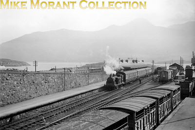 A lovely panorama of Kyle of Lochalsh station with a Caledonian 2P 0-4-4T holding centre stage, cattle wagons in the foreground and the Isle of Skye as the backdrop. [Mike Morant collection]
