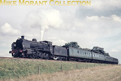 An undated view of Maunsell 'N' class mogul no. 31410 in charge of the 2.55 Brighton to London brisge service depicted here near Edenbridge Town. [Mike Morant collection]
