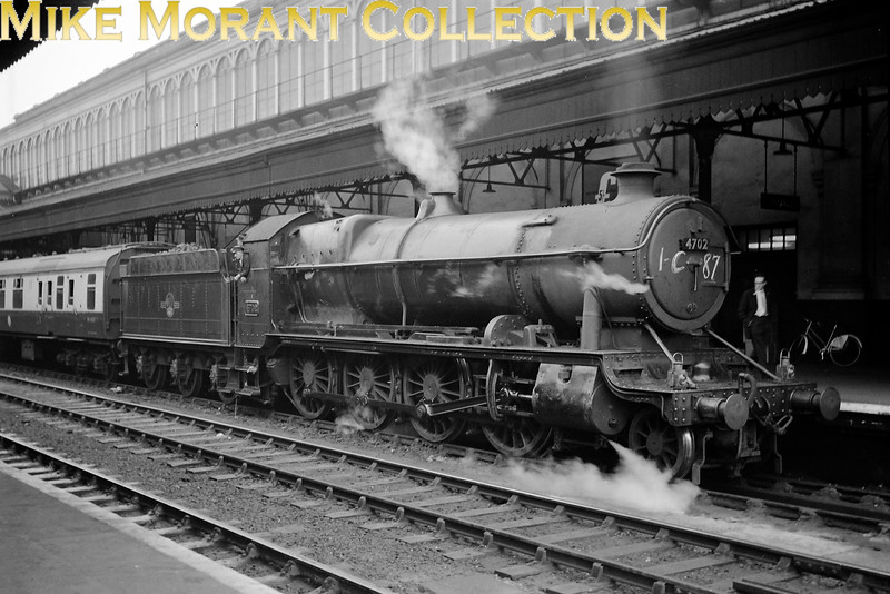 Churchward 7F 2-8-0 no. 4702 in charge of a down excursion at Exeter, St. David's. The chalked reporting number 1-C87 on the smokebox door is probably significant. 4702 has an 81A Old Oak Common shed plate which dates this shot to October 1961 or earlier.<br> [<i>Mike Morant collection</i>]