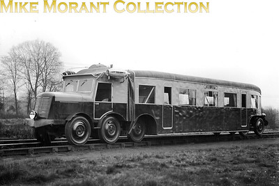 This is the short-lived French experiment using rubber tyres under a custom built, diesel engined bus body for use on branch lines. Called the Micheline, following trials in France it was brought to England in 1932 where it was tested by the LMSR for a month on Bletchley to Oxford services, Alton to Ascot on the Southern and Crewe to Wellington on the GWR but was found to be wanting and that seems to have been the end of the experiment, certainly in the UK. This negative isn't documented but was probably taken at Coventry in April 1932. [Mike Morant collection]