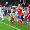 The teams come out prior to the Vanarama Conference Premier match between Aldershot Town and Eastleigh at the EBB Stadium Aldershot (photo by Paul Paxford/Pitchside Photo)