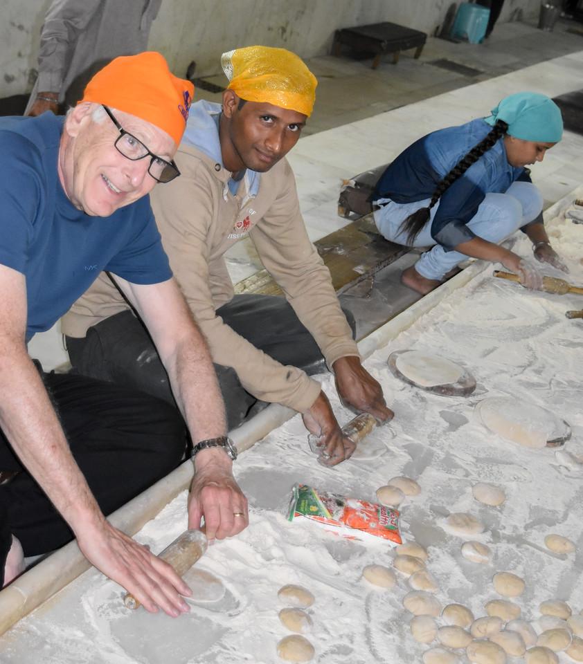 Allen preparing bread at the Sikh Temple
